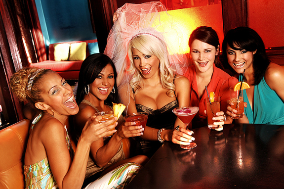 Five young women celebrating at a bachelorette party
