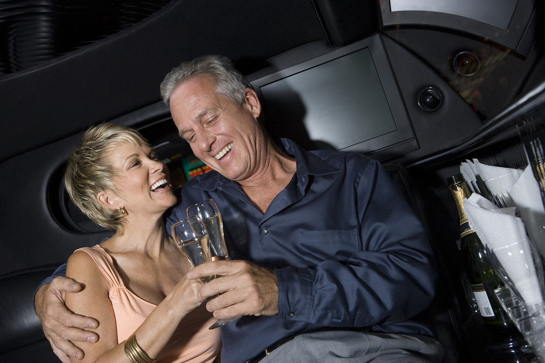 older couple toasting champagne in a limo in Scottsdale