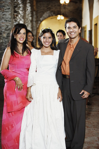Mother, father and daughter at her quinceañera