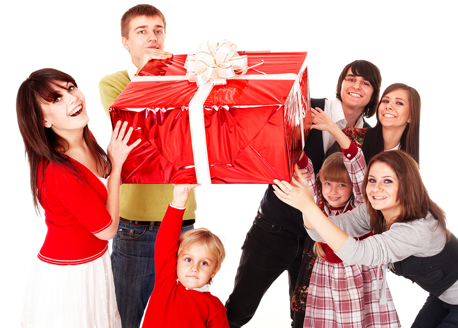 Big family offering up a gift